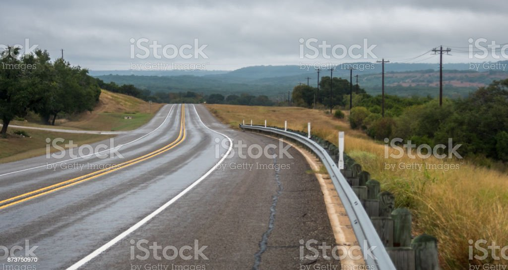 View of Country Road With Cloudy Skies stock photo