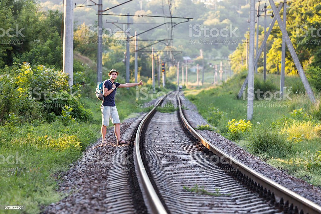 View of countryside Railroad and Hiker waiting the Train stock photo