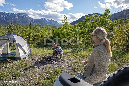 istock View of couple relaxing outside campsite in the morning 1251371873
