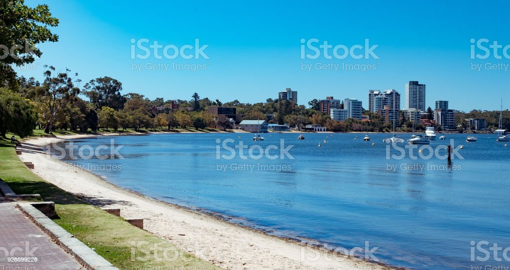 view of curved  river side  on bay back to apartment buildings stock photo