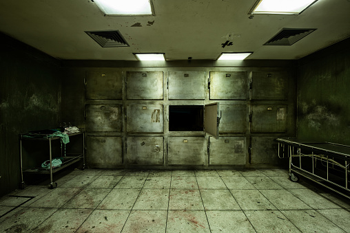 Room look scary, similar to used by the hospital to collect dead body, wait for religious ceremony or medical study was created for Halloween frightful Concept.