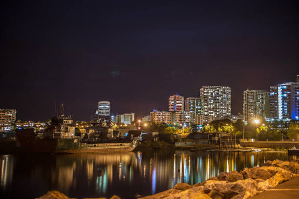 view of darwin at night from fishermans wharf, darwin - darwin stock photos and pictures