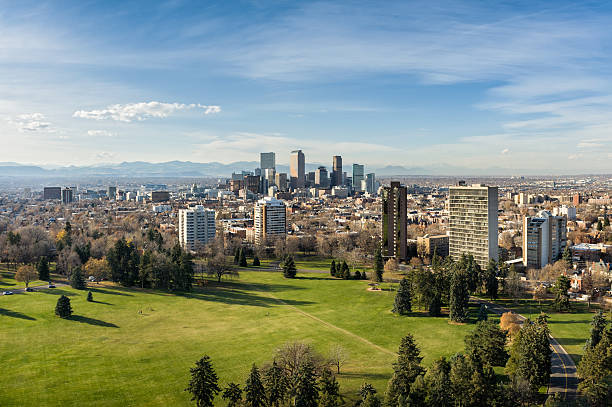 View of Denver Colorado Skyline View of Denver Colorado Skyline.  Looking at city with mountains in background - Cheeseman Park.  Converted from 14-bit Raw file.  sRGB color space. denver stock pictures, royalty-free photos & images