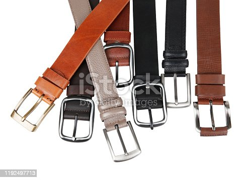 View of different new leather belts with buckles. Without shadows. Isolated on white background