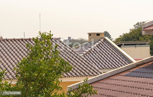 View of different roofs constructed of clay tiles in residential neighborhood houses in southern Brazil. Architecture and design. Construction.