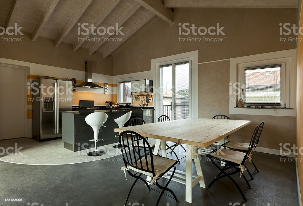 view of dining table and kitchen stock photo