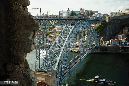 View of Dom Luis I bridge and the Douro river from abandoned building.