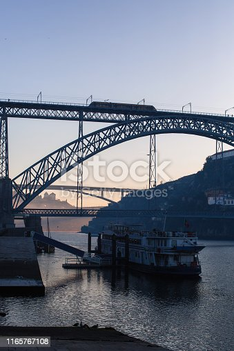 View of Douro river and Dom Luis I bridge from Ribeira early in the morning, Porto, Portugal.