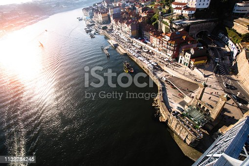 View of Douro river and Ribeira from Dom Luis I iron bridge, Porto - Portugal.