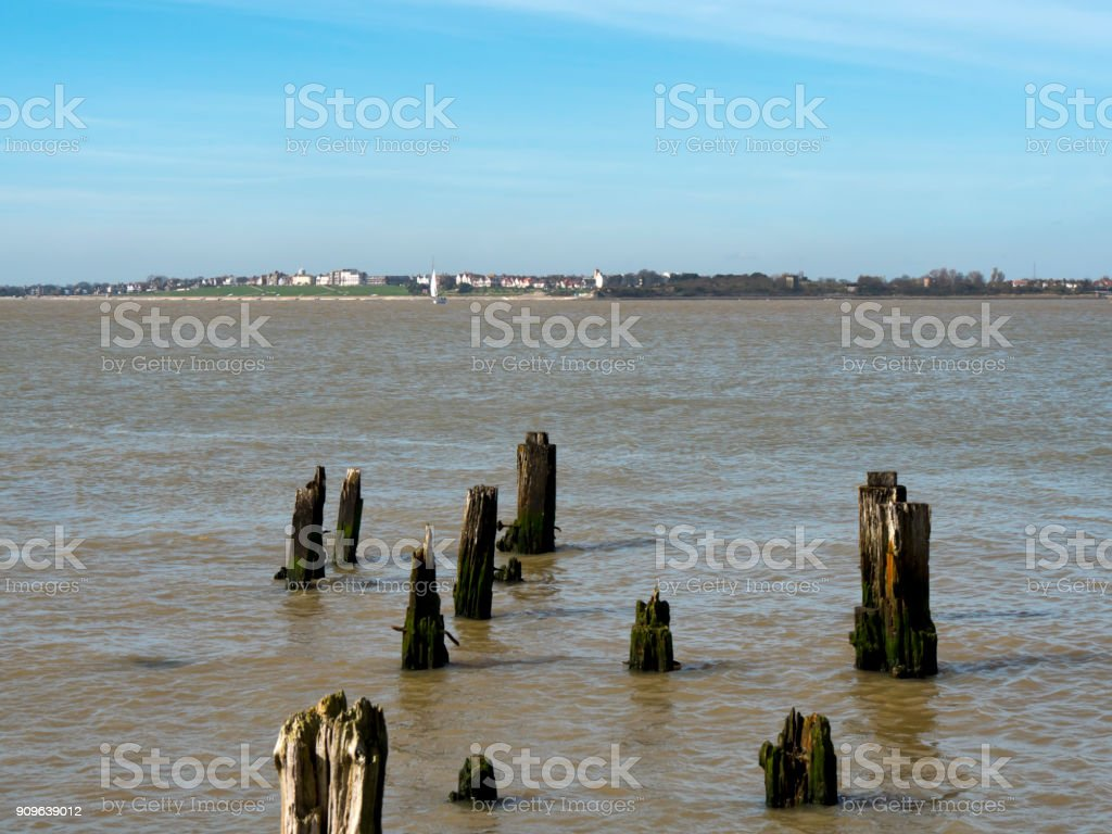 View of Dovercourt, Essex, with the remains of an old wooden jetty stock photo