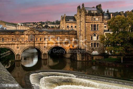 downtown Bath, England, in the late afternoon, showing the River Avon and the old stone Pulteney Bridge crossing it