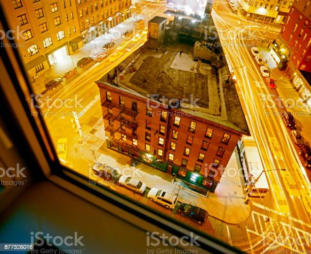 A view of downtown NYC street and building from a window