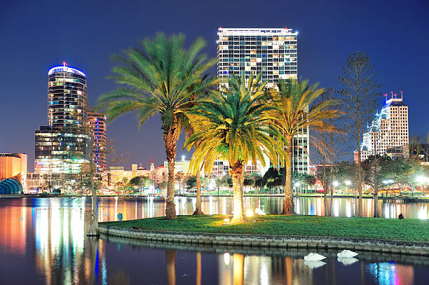 view of downtown orlando at night - orlando florida photos stock photos and pictures