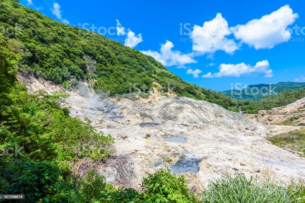 View of Drive-In Volcano Sulphur Springs on the Caribbean island of St. Lucia. La Soufriere Volcano is the only drive-in volcano in the world. View of Drive-In Volcano Sulphur Springs on the Caribbean island of St. Lucia. La Soufriere Volcano is the only drive-in volcano in the world. Antilles Stock Photo