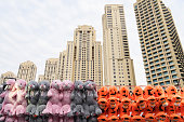 Dubai - January 30: View of Dubai Marina skyscrapers and colorful stuffed animal toys on January 30, 2017.