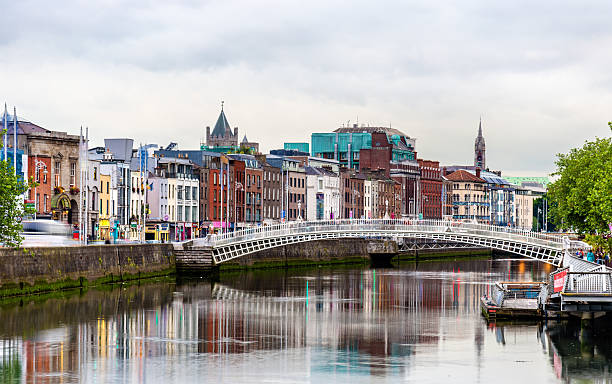 view of dublin with the ha'penny bridge - ireland - republic of ireland stock pictures, royalty-free photos & images
