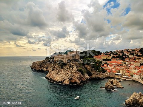 Vew of Dubrovnik city and a small castle on an island at the edge of the ocean in Croatia