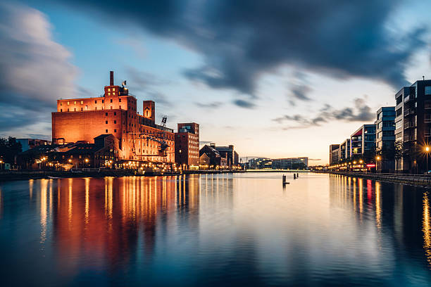 view of Duisburg Inner Harbour at dusk View of Duisburg Inner Harbour, Germany north rhine westphalia stock pictures, royalty-free photos & images