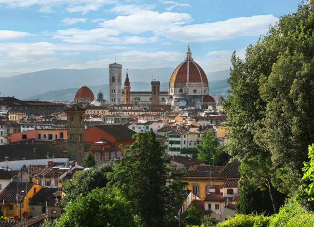 View of Duomo Santa Maria Del Fiore (Florence Cathedral) in evening as viewed from Piazzale Michelangelo in Florence (Firenze), Tuscany, Italy stock photo