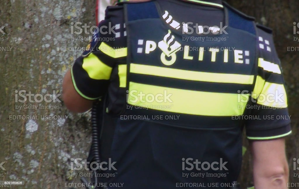 View Of Dutch Police Officer In Police Uniform Standing On The Street Of The Hague South Holland The Netherlands Europe stock photo