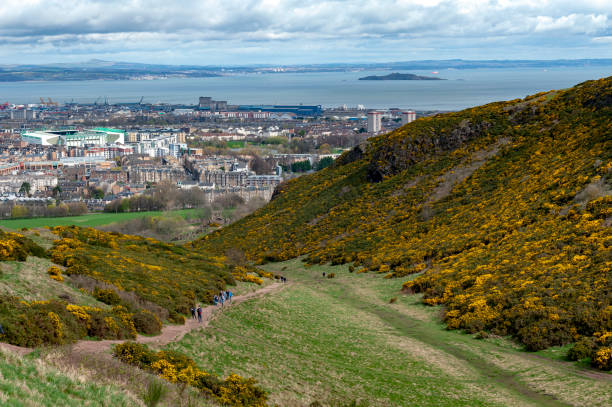 View of Edinburgh city towards coastal area of the North Sea from Arthur's Seat, the highest point in Edinburgh located at Holyrood Park, Scotland, UK stock photo