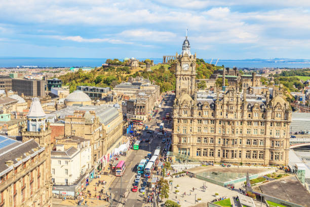 View of Edinburgh with Princes Mall from elevated position Photograph of Edinburgh from the Scott Monument overlooking east on Princes Street photographed in the sunshine in September 2014 princes street edinburgh stock pictures, royalty-free photos & images