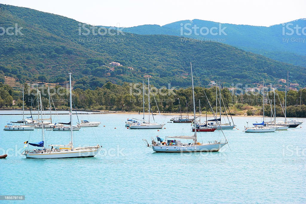 View of Elba Island, Italy. With the sailboats royalty-free stock photo