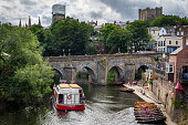 istock View of Elvet Bridge over river Wear in the historic town Durham. Towers of Durham Cathedral in background. 1035755492
