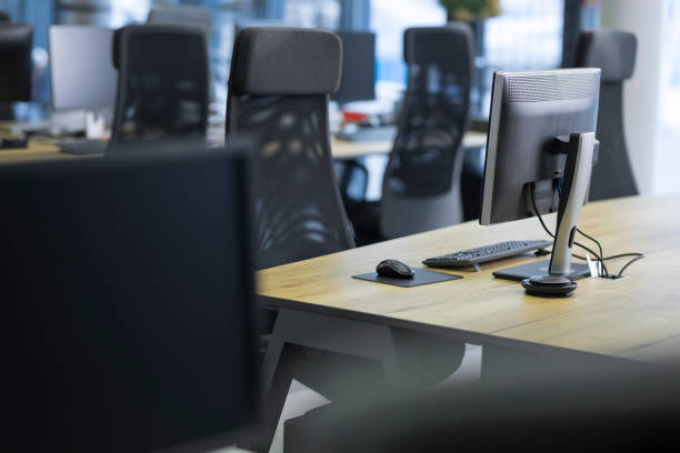 View of empty call centre office Interior of an empty workstation in call centre office. empty desk stock pictures, royalty-free photos & images