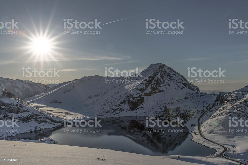 View of Enol lake snowy in winter stock photo