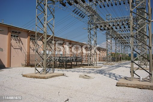 Medium voltage switchyard building and steel construction for medium voltage overhead line connection configuration