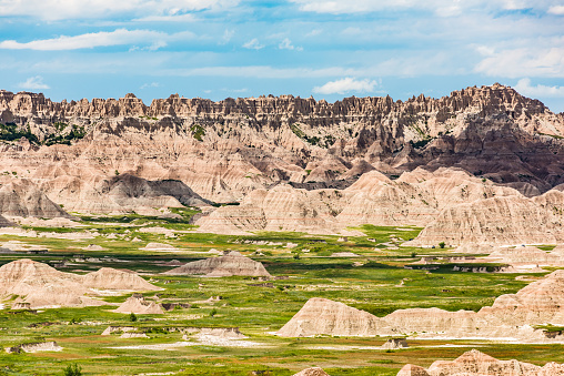 istock View of eroded Badlands canyons with green prairie 601370148