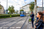 MUNICH, GERMANY - SEPTEMBER 15, 2018: View of european city with tram. People are ready to cross a street.