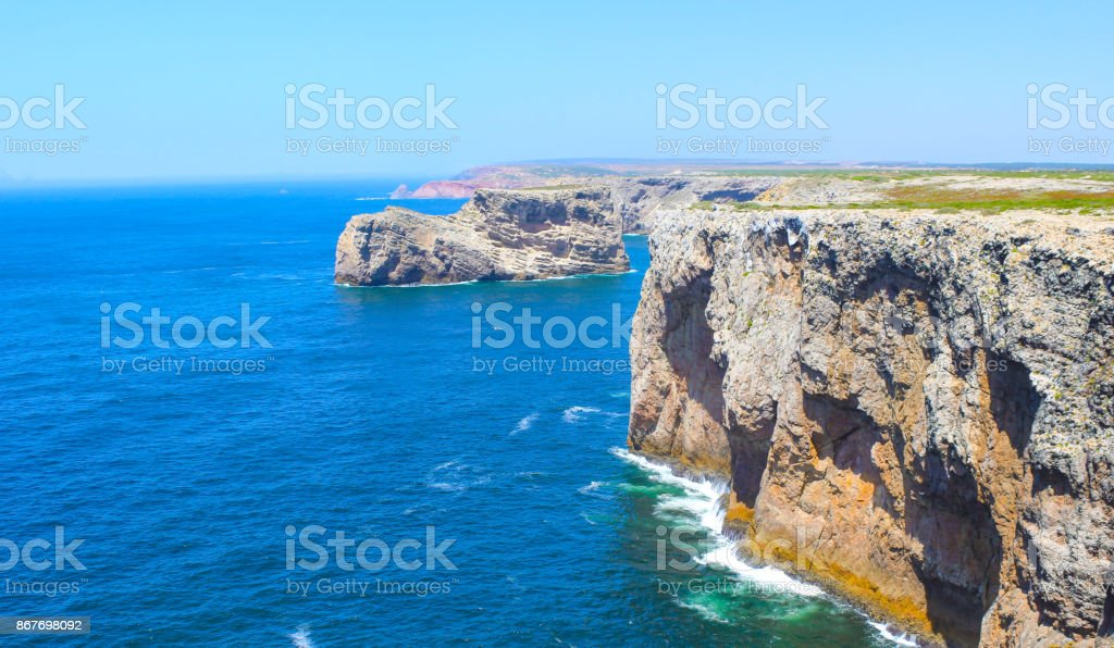 View of famous Cliffs of Moher and wild Atlantic Ocean, Portuguese coastline close to Cape St. Vincent in Portugal on a sunny and clear day with the beautiful blue Atlantic in the background. stock photo