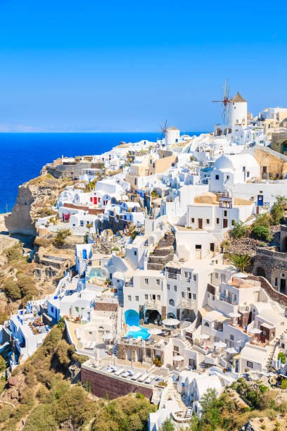 Greece View of famous windmill and white houses in Oia village on Santorini