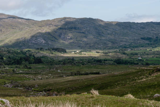View of farms beneath a ridge of Mass Mount stock photo
