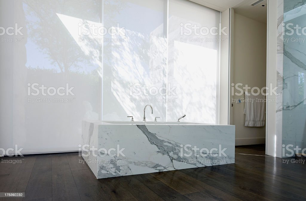 View of faucet and a marble sink in a modern bathroom royalty-free stock photo