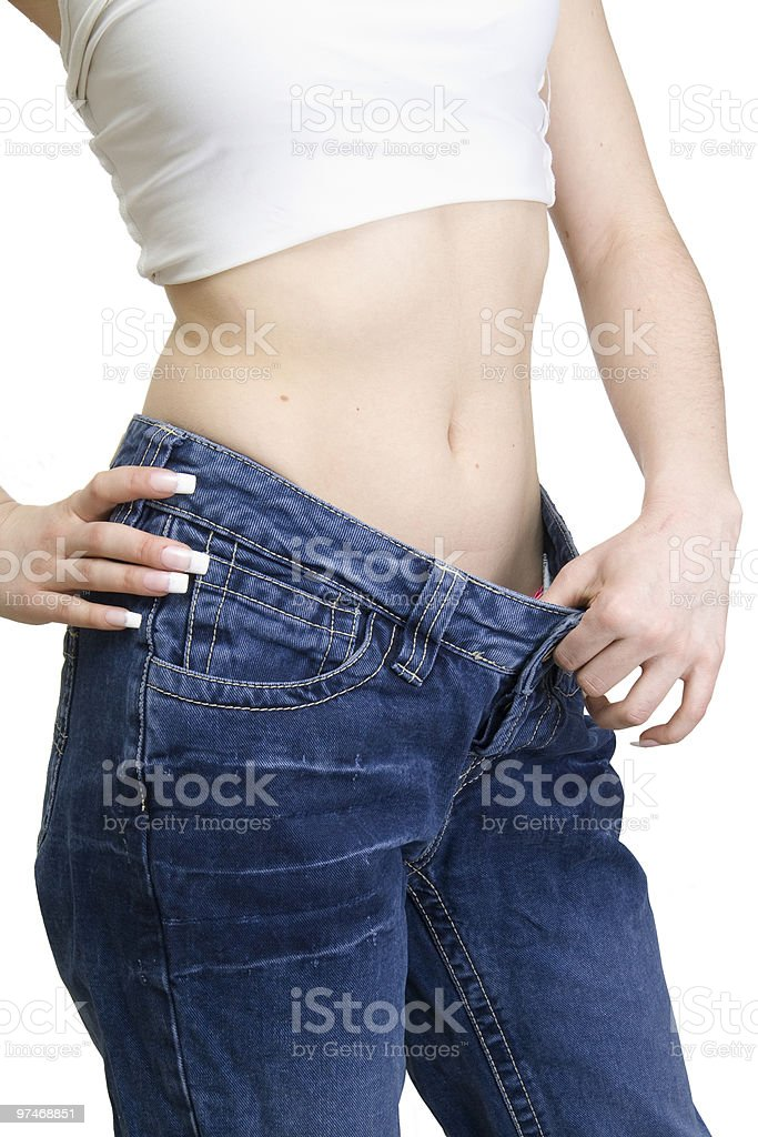 View of female became skinny and wearing old jeans royalty-free stock photo
