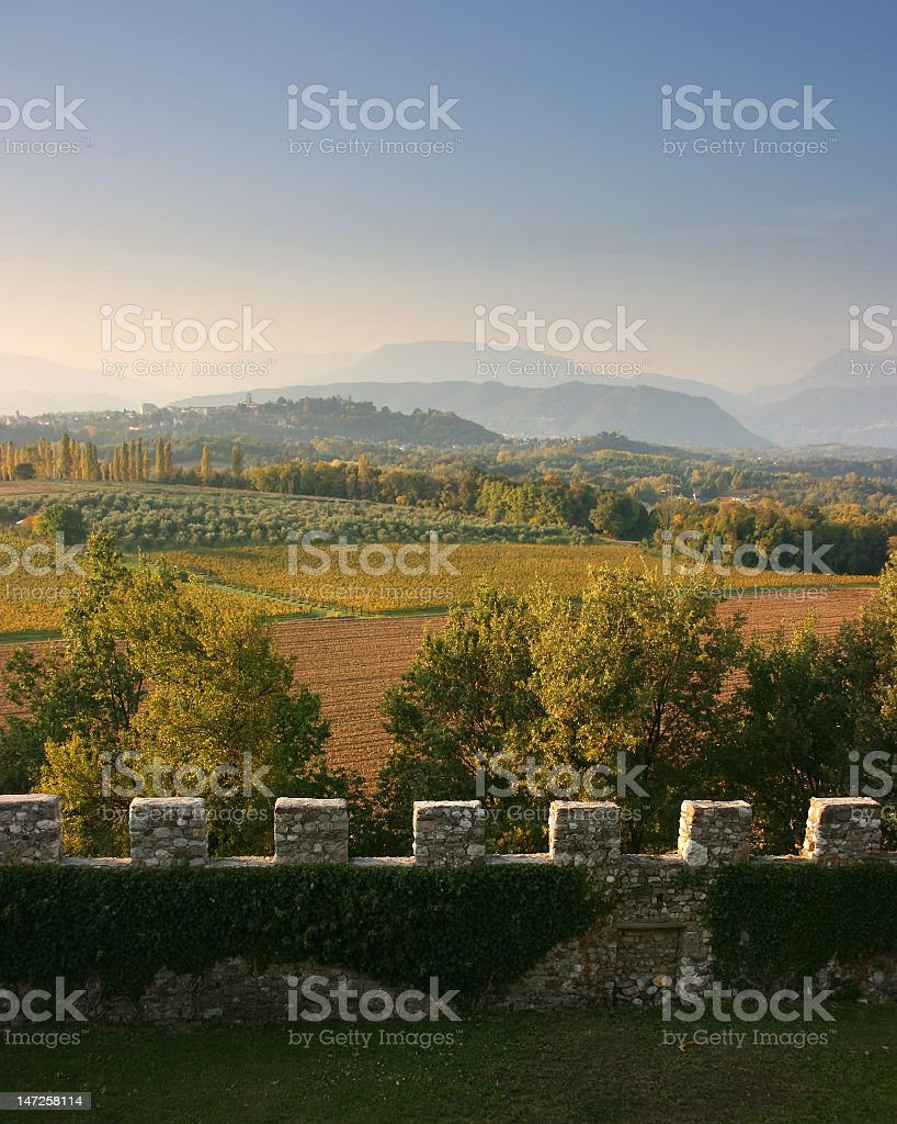 View of fields and pastures from a castle stone wall stock photo