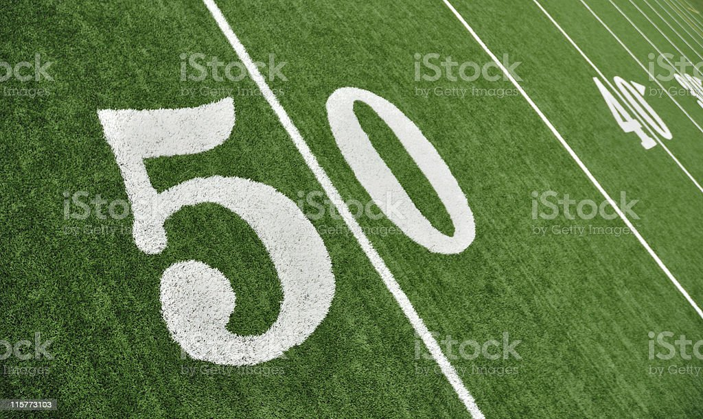 View of Fifty Yard Line on American Football Field royalty-free stock photo