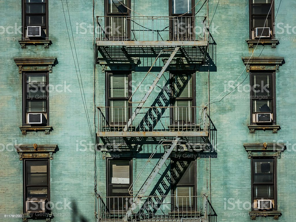 View of fire escape outside green New York apartment stock photo