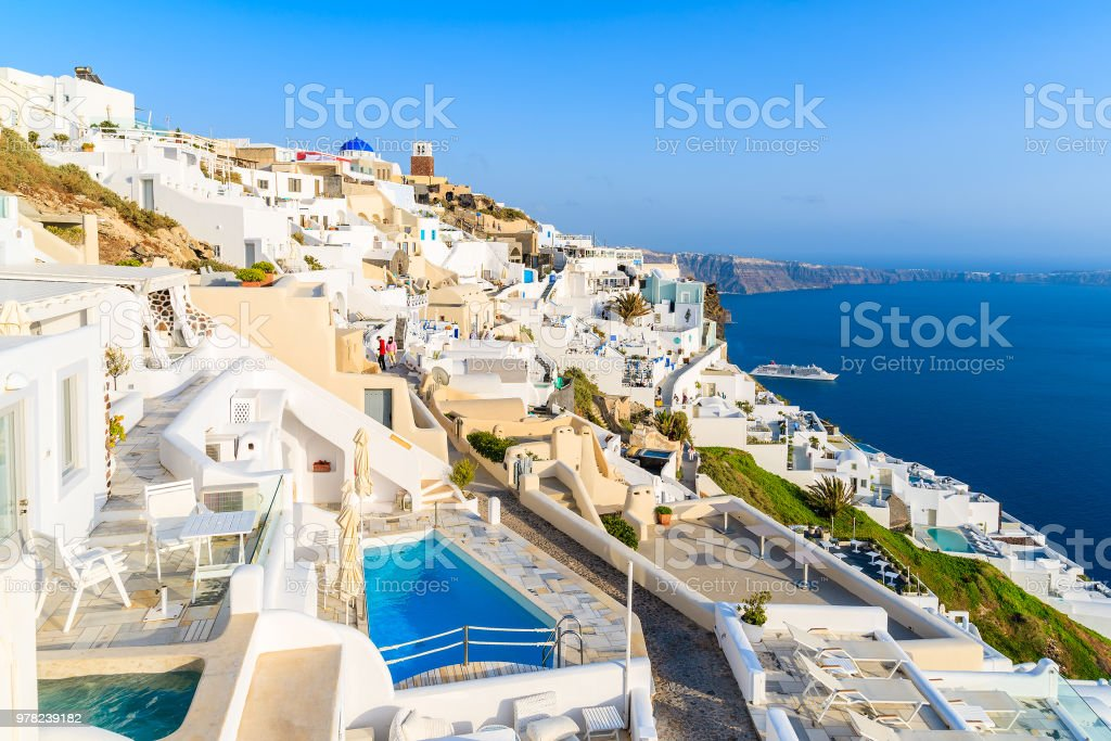 View of Firostefani village with many boutique hotels built on cliff side, Santorini island, Greece stock photo