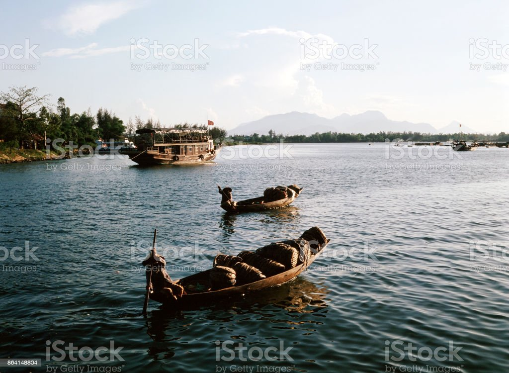 A view of fisherman and a boat in Saigon Vietnam royalty-free stock photo
