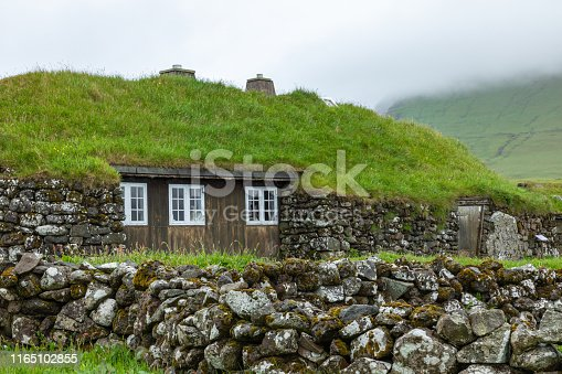 View of fishing village in Koltur island. Faroe Islands. Green roof houses. Nordic natural landscape.