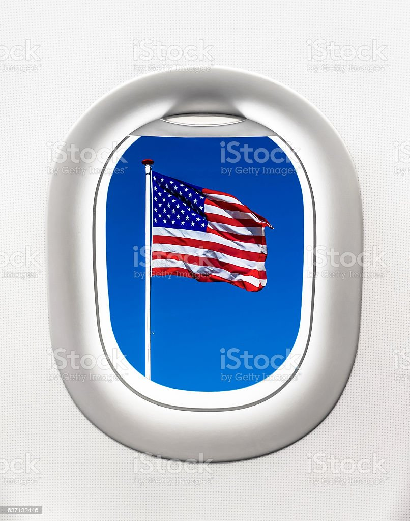 View of flag of USA from airplane window - flight concept