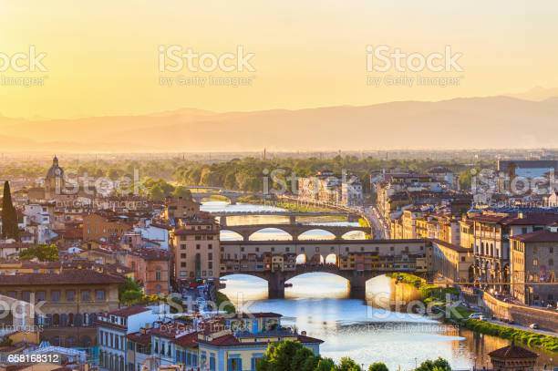 View of florence at sunset with the ponte vecchio bridge and the arno picture id658168312?b=1&k=6&m=658168312&s=612x612&h=sp5cjl5jtrrtyyutuomeuu56k ojcs3zx hglhoqhbc=