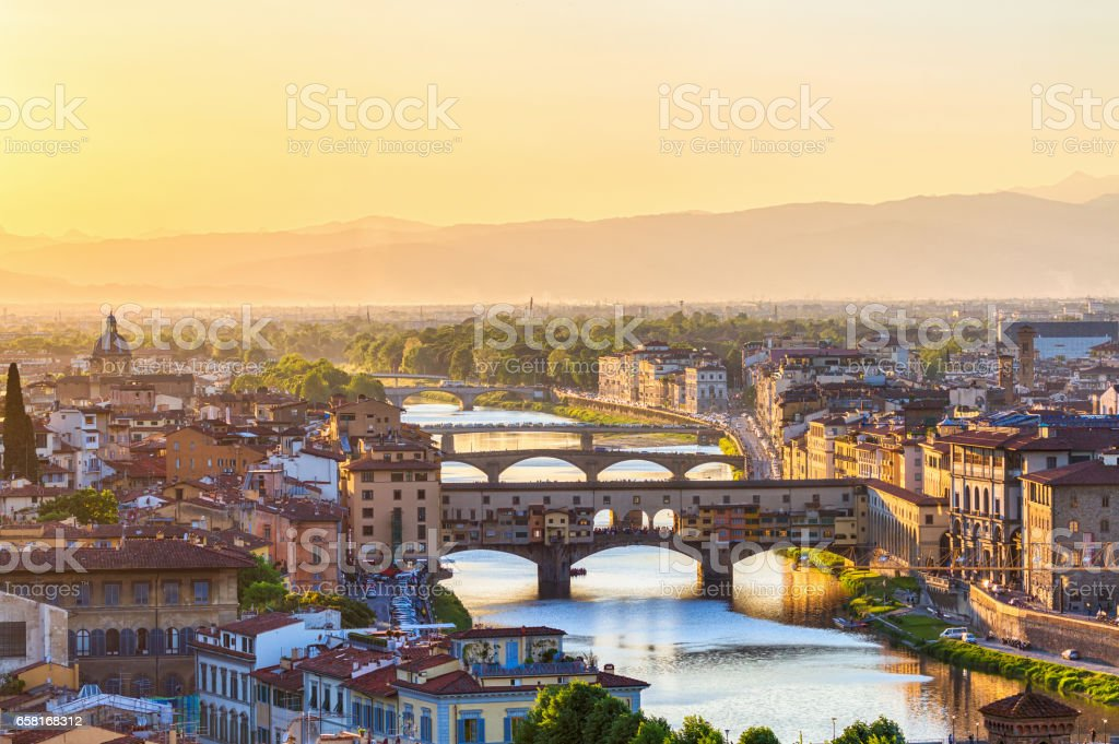 View of Florence at sunset with the Ponte Vecchio Bridge and the Arno River stock photo