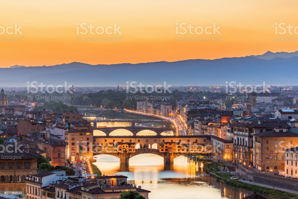 View of Florence at sunset with the Ponte Vecchio bridge over the Arno River stock photo