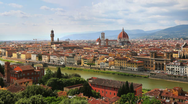 View of Florence Cathedral (Duomo Santa Maria Del Fiore) and Palazzo Vecchio in Florence skyline during evening in Florence, Italy stock photo