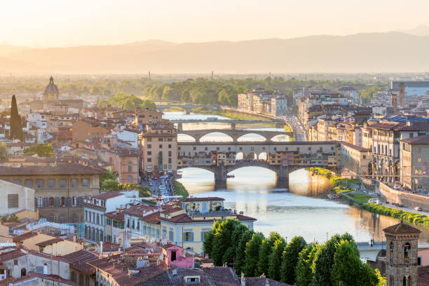 View of Florence in the evening light with the Ponte Vecchio bridge View of Florence in the evening light with the Ponte Vecchio bridge florence italy stock pictures, royalty-free photos & images